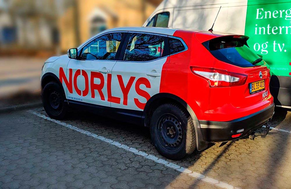 Bildekorationer på Norlys' varevogne